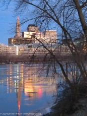 The city reflecting in a thin layer of ice.