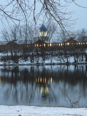 The Colt Dome reflected in a moving river.