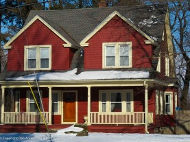 The two large dormers make this look like a two-family house. Red door - yay!