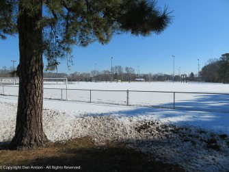 The park is still covered in snow.