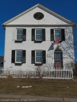 Build in 1824, featuring working shutters and a fan louver for attic ventilation.