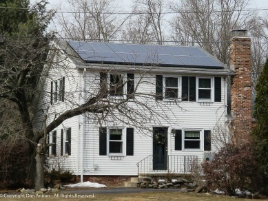 Old house, historic neighborhood, narrow door, solar power.
