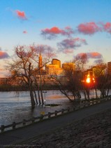 Sun rising on Hartford and a swollen CT River.