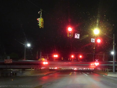 Late night train at the crossing.