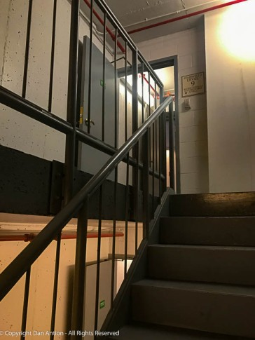 The stairwell doors were propped open for ventilation.