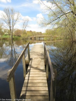 Looking out along the dock at the boathouse to the Old North Bridge.