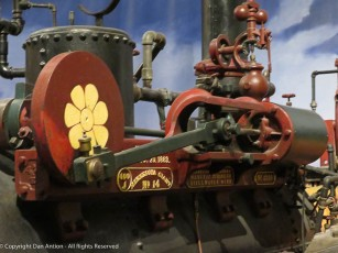The working end of the steam engine. The piston drives the flywheel is connected to the drive wheel on the other side.