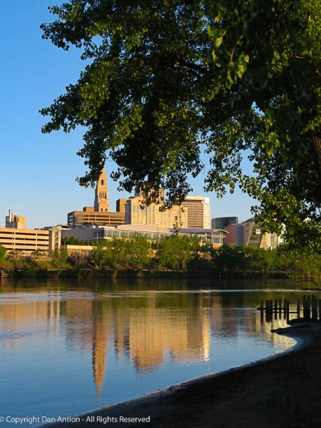 Hartford's reflection is fuller than normal. More river.