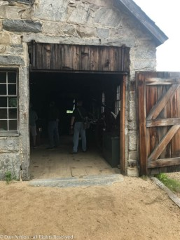 That's the main entrance to the blacksmith shop. The transom portion is actually another door. If you look close, you'll see hinges that allow it to open up for tall items.