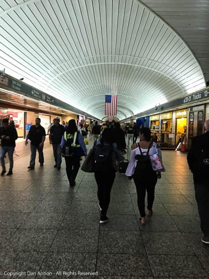 Walking through Penn Station toward the 7th Avenue subways.