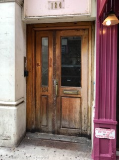 I like disproportionately split doors. These has seen better days, but I'd like to enter through these.