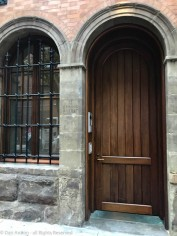 You can't go wrong with an arched door in a stone and brick wall.