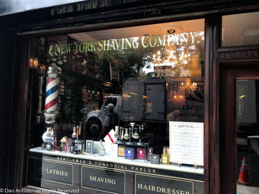 I had to include this barber shop. I love the dark color and the reflections.
