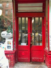 Butcher shop. I thing Brad an I are both reflected in those beautiful red doors.