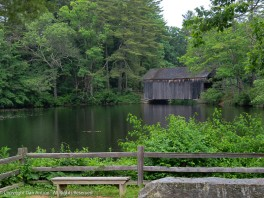 The walking path crosses the Quinebaug River via that covered bridge. It used to be farther up river, but it broke loose during the 1955 flood and the restored it at this location.
