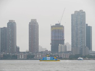 I love the pop of color. That's the NYC Water Taxi. I've been on that, it's a pretty quick ride.