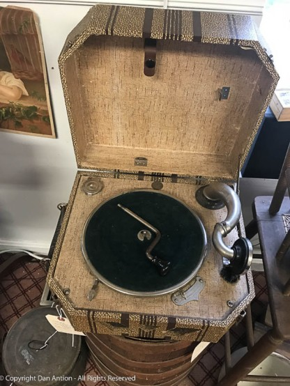 This is one version of an old portable phonograph. I tried to alter this a bit to hide the price tag.