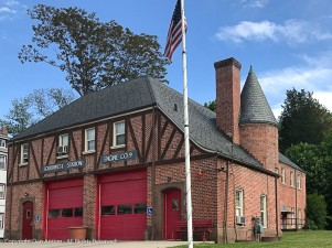 This is the before (the original) photo of the firehouse. Note the window A/C units and the Handicapped Parking signs.