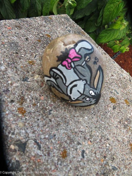 """""""Thanks for noticing!"""" Someone left this painted rock of Eeyore in the park."""