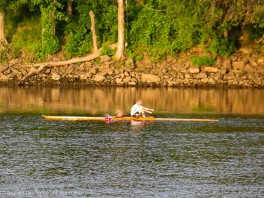 "This guy is rowing in the ""ship canal"" which might be deep enough for his scull."