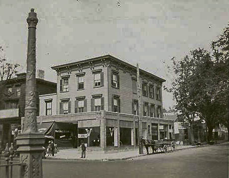 """1922 - Armbruster .... The former Monument Hotel. At the time of the photo the building houseD an automobile sales and service business. The building was demolished in the 1950s.; """"w cor Broadway + Linden Ave Flushing 1922"""" Brad says: """"If you want a reservation, be sure to ask for a high floor, corner room. If you are near the front corner of the building you will be awakened by the milk deliveries."""""""