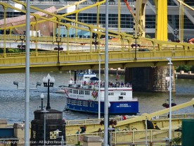 One of the boats in the Gateway Clipper fleet, heading under the 6th Street bridge in Pittsburgh. I like the lines in this image.