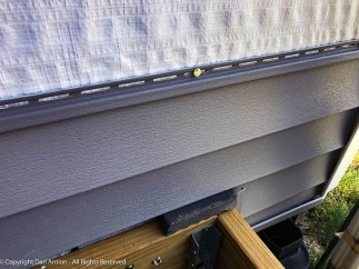 That is a full-thickness piece of decking. I like that it fits under the siding.