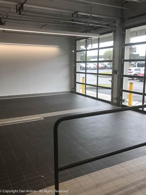 Brand-spanking new doors at the car dealership. They moved here about a month ago. Tile floor in the service department?