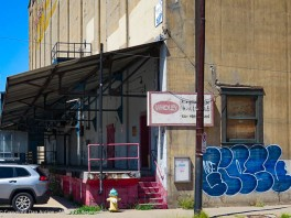 This loading dock was featured in an earlier post, but the focus today is on the little door behind the fireplug.