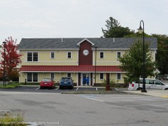 This building sits across the lot from the historic buildings.