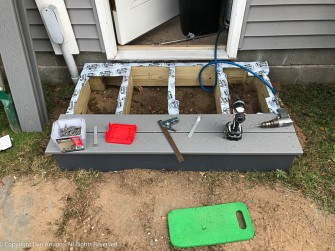 This is the step to the side door of the garage. The butyl tape is to prevent water from laying on the joists and entering the screw holes.