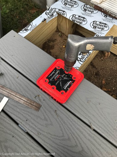 I prefer to drill small pilot holes for the deck screws. The cap from the screw box can be used to both center the holes on the joists and locate the screws the appropriate distance from the edge of the board.