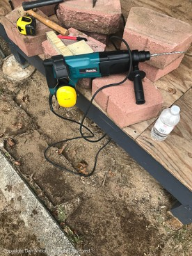 More tools of the trade. A hammer drill makes short work of drilling holes in concrete.
