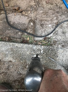 Once a series of holes are drilled in the concrete, the concrete can be chiseled out.