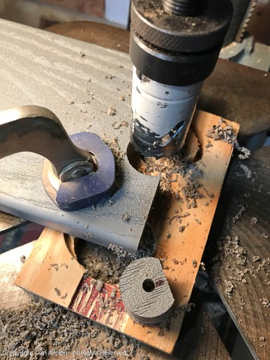 The continuing curved (points) at the end of the hole will be removed with a rasp to turn the circle into a U-shape opening.