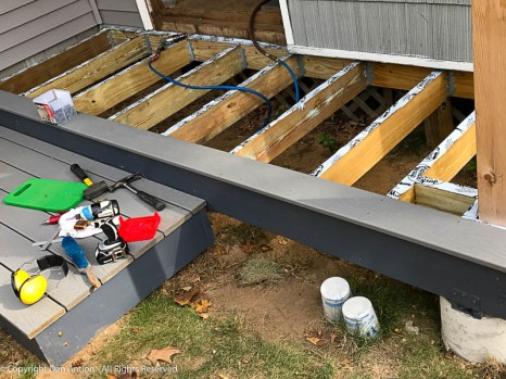 "These boards are a 11' 2"" (3.4m) long. Since the house side is tucked under the siding, I anchored the outside edge at the end and along the front."
