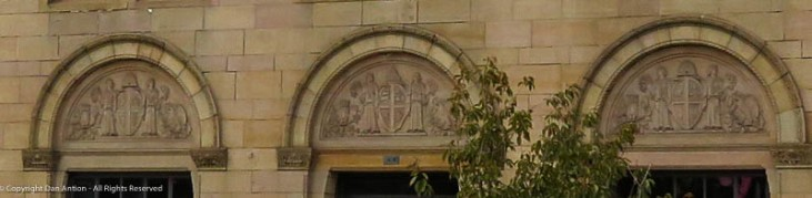 Carvings over the windows of the Five Cent Savings Bank building.