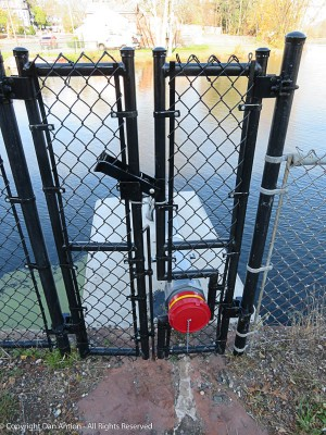 An interesting gate, This is a fire department water supply that allows them to pump water out of the Mill Pond.