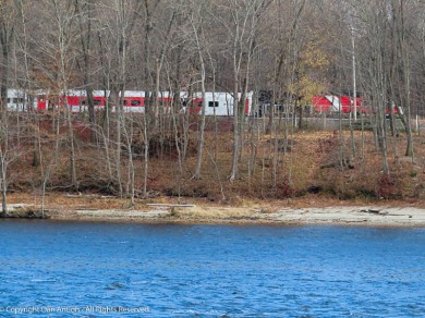 That's a CT-Rail train across the river, on its way to New Haven (about 45 minutes away).