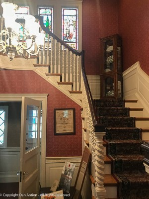 Beautiful staircase and curio cabinet.