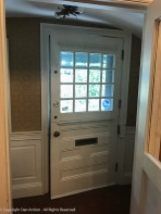 I noticed, on my way out, that the main door is a dutch door where the upper half can be opened.