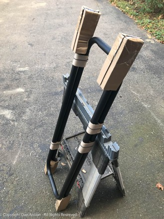 """The """"handrails"""" are actually firewood racks. I had to cut the brackets off of them. That took about 10 seconds with the bandsaw."""