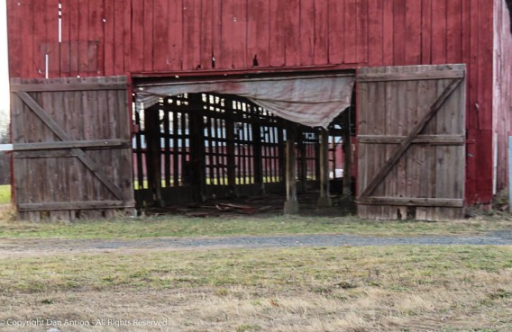 They are removing pieces of this barn before tearing it down.