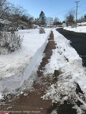 Since the sidewalk gets snow plus the stuff the plows puch off the road, this was slow-going.