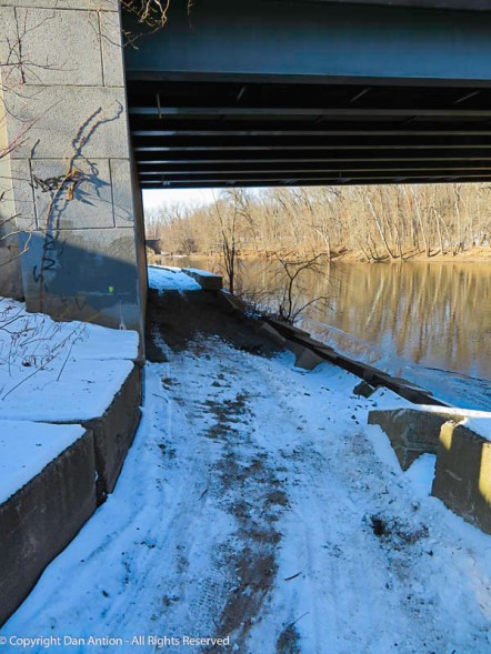 If this snow and ice hadn't melted, I might not want to walk under that bridge.