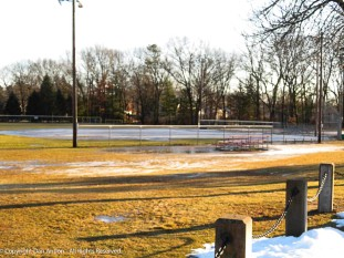 The snow is mostly gone, but the ball field isn't ready for spring training yet.