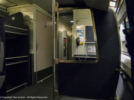 AMTRAK Metroliner coach car. That's the restroom door on the left, but just right of center - that's a payphone.