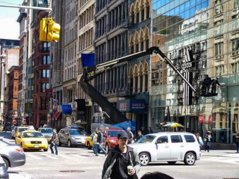 On Broadway in lower Manhattan. Can you tell what's real and what's reflection?