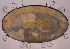 """Text: On both sides, inside top of oval, """"L.CHURCHILL,S"""" over """"""""HEMINGWAY"""", inside bottom of oval, """"INN"""", over """"TAVERN"""", in center of oval, """"1838"""" over """"STORE."""""""