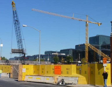 This is across from the Javits Center. I'm using that plywood door on the left as an excuse to include three cranes.